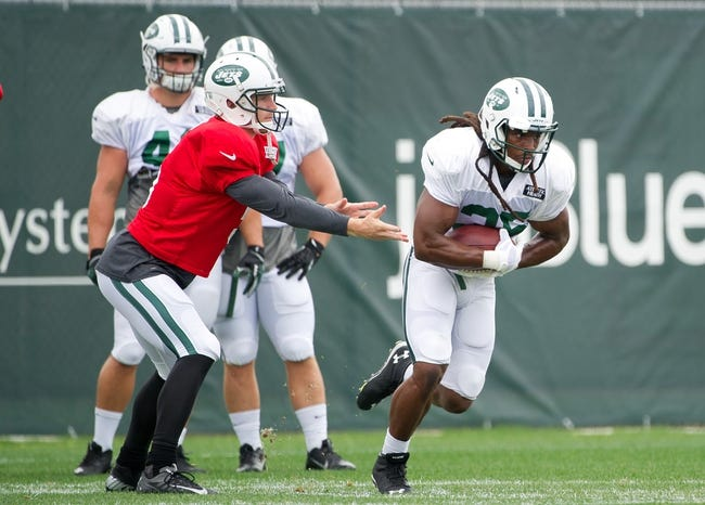 Aug 4, 2014; Cortland, NY, USA; New York Jets quarterback Matt Simms (left) hands the ball off to running back Daryl Richardson (right) at training camp at SUNY Cortland. Mandatory Credit: Rich Barnes-USA TODAY Sports