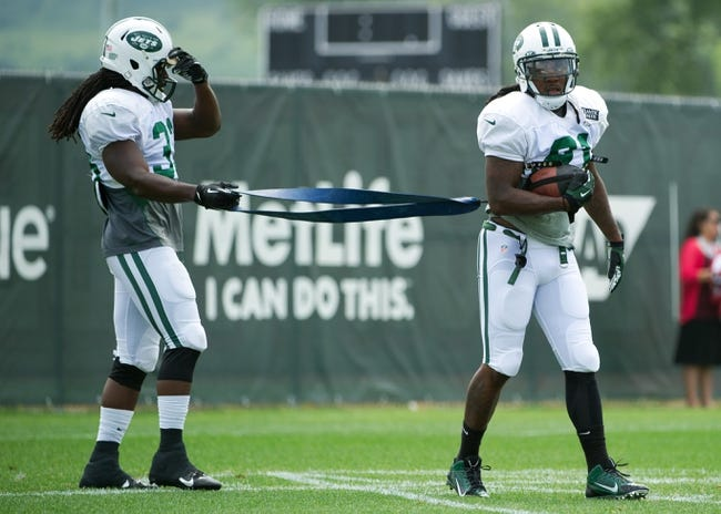 Aug 4, 2014; Cortland, NY, USA; New York Jets running back Chris Ivory (left) and New York Jets running back Chris Johnson (right) work together during drills at training camp at SUNY Cortland. Mandatory Credit: Rich Barnes-USA TODAY Sports