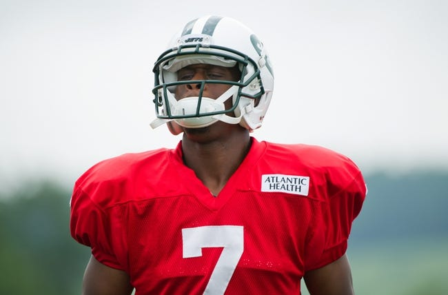Aug 4, 2014; Cortland, NY, USA; New York Jets quarterback Geno Smith (7) looks on during training camp at SUNY Cortland. Mandatory Credit: Rich Barnes-USA TODAY Sports
