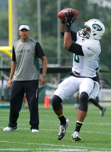 Aug 4, 2014; Cortland, NY, USA; New York Jets wide receiver Michael Campbell (18) makes a catch as wide receivers coach Sanjay Lal looks on during drills at training camp at SUNY Cortland. Mandatory Credit: Rich Barnes-USA TODAY Sports
