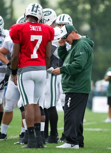 Aug 4, 2014; Cortland, NY, USA; New York Jets offensive coordinator Marty Mornhinweg (right) talks with quarterback Geno Smith (7) during training camp at SUNY Cortland. Mandatory Credit: Rich Barnes-USA TODAY Sports