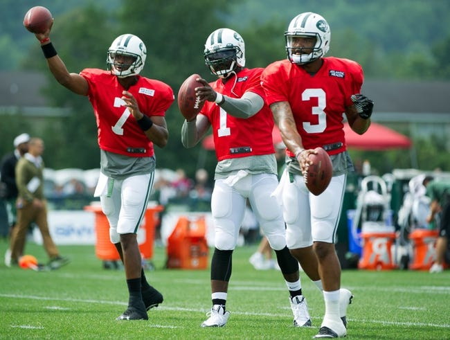 Aug 4, 2014; Cortland, NY, USA; New York Jets quarterbacks Geno Smith (left) and Michael Vick (center) and Tajh Boyd (right) during drills at training camp at SUNY Cortland. Mandatory Credit: Rich Barnes-USA TODAY Sports