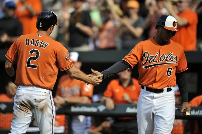Aug 9, 2014; Baltimore, MD, USA; Baltimore Orioles shortstop J.J. Hardy (2) is congratulated by Jonathan Schoop (6) after scoring in the second inning against the St. Louis Cardinals at Oriole Park at Camden Yards. Mandatory Credit: Joy R. Absalon-USA TODAY Sports