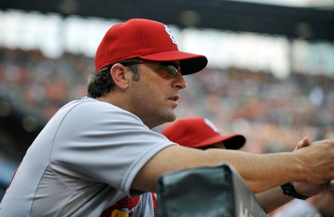 Aug 9, 2014; Baltimore, MD, USA; St. Louis Cardinals manager Mike Matheny (22) during a game against the Baltimore Orioles at Oriole Park at Camden Yards. Mandatory Credit: Joy R. Absalon-USA TODAY Sports