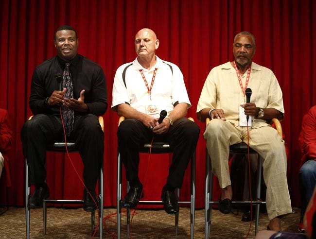 Aug 9, 2014; Cincinnati, OH, USA; Cincinnati Reds former center fielder Ken Griffey, Jr. (left), second baseman Ron Oester(center), and right fielder Dave Parker (right), speak at a news conference at Great American Ball Park. The three will be inducted into the Reds Hall of Fame in ceremonies before a game between the Miami Marlins and the Cincinnati Reds. Mandatory Credit: David Kohl-USA TODAY Sports