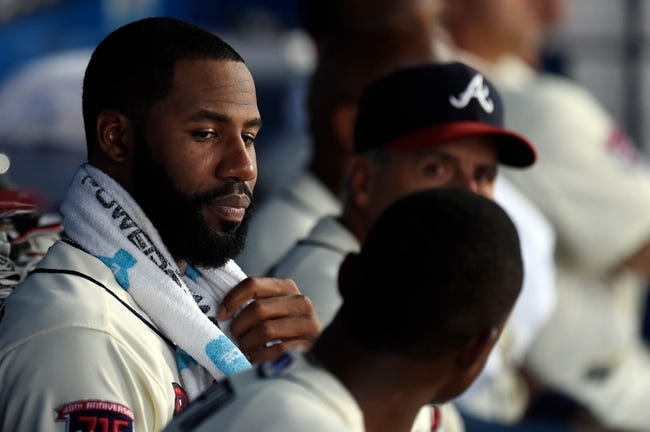 Aug 9, 2014; Atlanta, GA, USA; Atlanta Braves right fielder Jason Heyward (22) talks to center fielder B.J. Upton (2) (foreground) during a rain delay prior to the game against the Washington Nationals at Turner Field. Mandatory Credit: Dale Zanine-USA TODAY Sports