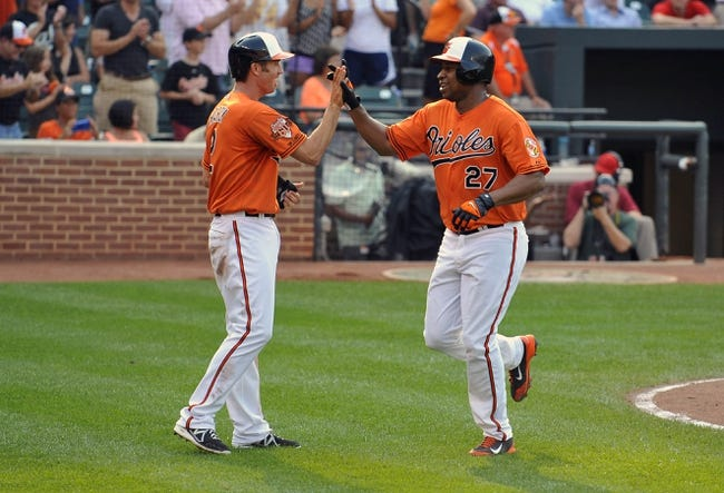 Aug 9, 2014; Baltimore, MD, USA; Baltimore Orioles left fielder Delmon Young (27) is congratulated by J.J.Hardy (2) after hitting a two-run home run in the fifth inning against the St. Louis Cardinals at Oriole Park at Camden Yards. The Orioles defeated the Cardinals 10-3. Mandatory Credit: Joy R. Absalon-USA TODAY Sports