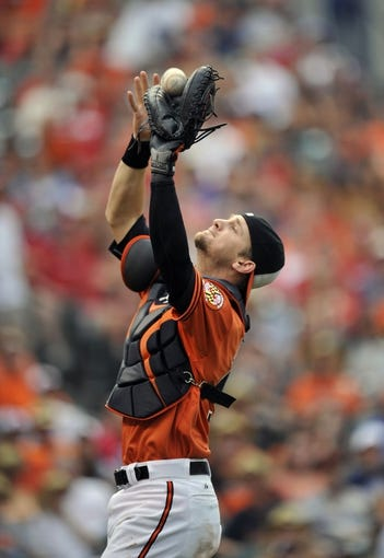 Aug 9, 2014; Baltimore, MD, USA; Baltimore Orioles catcher Caleb Joseph (36) catches a foul pop-up by St. Louis Cardinals designated hitter Jhonny Peralta (not shown) in the eighth inning at Oriole Park at Camden Yards. The Orioles defeated the Cardinals 10-3. Mandatory Credit: Joy R. Absalon-USA TODAY Sports