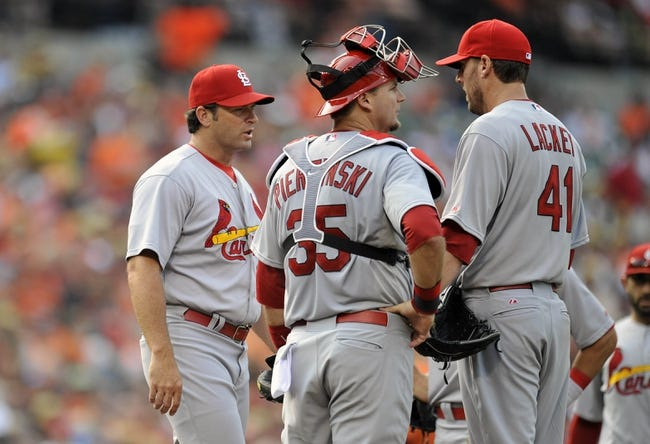 Aug 9, 2014; Baltimore, MD, USA; St. Louis Cardinals manager Mike Matheny (22) pulls starting pitcher John Lackey (41) in the sixth inning against the Baltimore Orioles at Oriole Park at Camden Yards. The Orioles defeated the Cardinals 10-3. Mandatory Credit: Joy R. Absalon-USA TODAY Sports