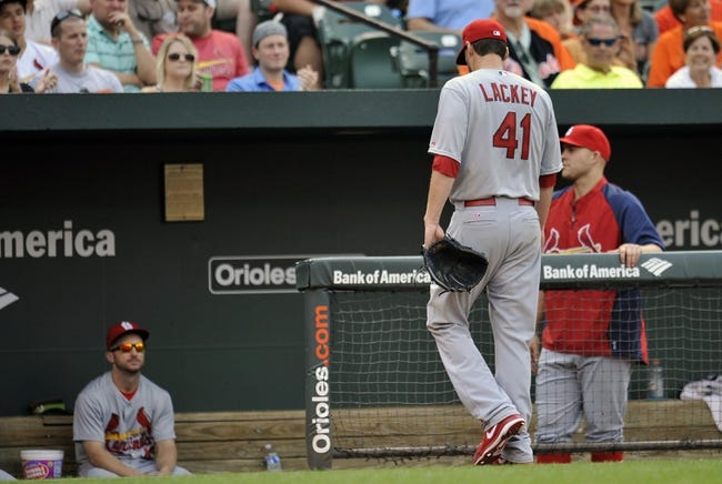 Aug 9, 2014; Baltimore, MD, USA; St. Louis Cardinals starting pitcher John Lackey (41) exits the game in the sixth inning against the Baltimore Orioles at Oriole Park at Camden Yards. The Orioles defeated the Cardinals 10-3. Mandatory Credit: Joy R. Absalon-USA TODAY Sports