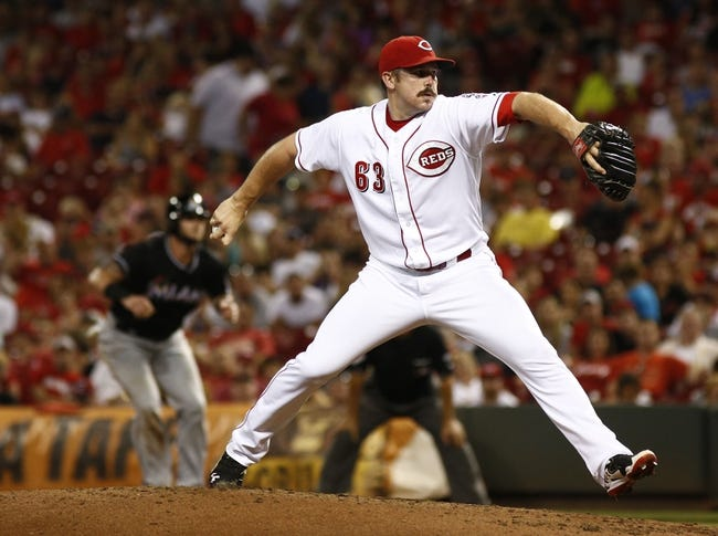 Aug 9, 2014; Cincinnati, OH, USA; Cincinnati Reds relief pitcher Sam LeCure (63) throws a pitch against the Miami Marlins in the sixth inning at Great American Ball Park. Mandatory Credit: David Kohl-USA TODAY Sports
