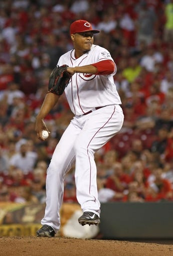 Aug 9, 2014; Cincinnati, OH, USA; Cincinnati Reds starting pitcher Alfredo Simon (31) looks to throw against the Miami Marlins in the fifth inning at Great American Ball Park. Mandatory Credit: David Kohl-USA TODAY Sports