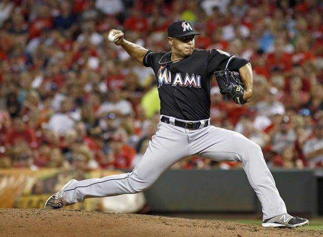 Aug 9, 2014; Cincinnati, OH, USA; Miami Marlins relief pitcher A.J. Ramos (44) throws a pitch against the Cincinnati Reds in the sixth inning at Great American Ball Park. Mandatory Credit: David Kohl-USA TODAY Sports