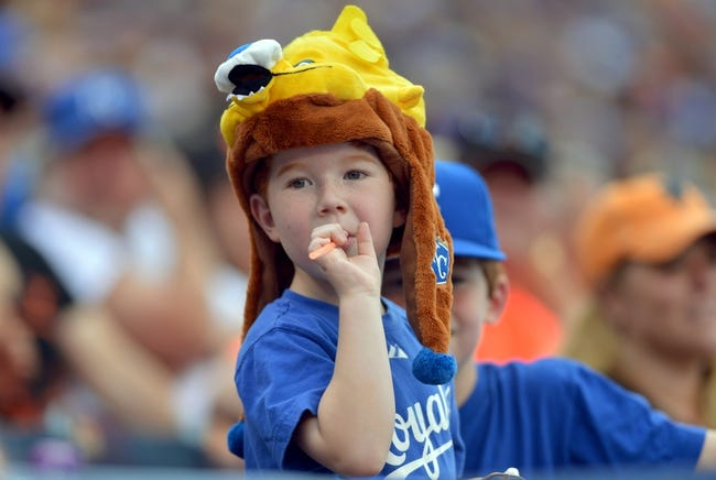 Aug 9, 2014; Kansas City, MO, USA; A young Kansas City Royals fan watches play in the second inning against the San Francisco Giants at Kauffman Stadium. The Royals won 5-0. Mandatory Credit: Denny Medley-USA TODAY Sports