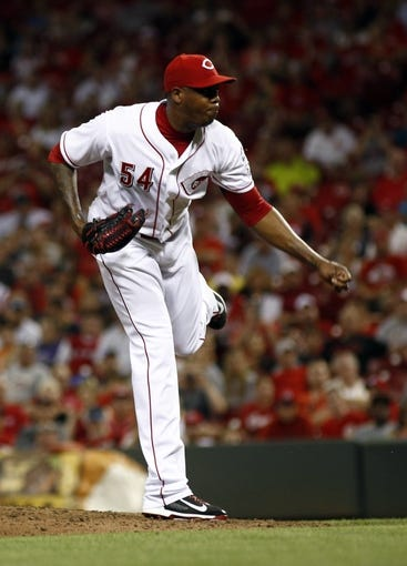 Aug 9, 2014; Cincinnati, OH, USA; Cincinnati Reds relief pitcher Aroldis Chapman (54) releases a pitch against the Miami Marlins in the ninth inning at Great American Ball Park. The Marlins won 4-3. Mandatory Credit: David Kohl-USA TODAY Sports