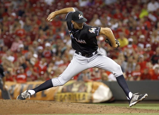 Aug 9, 2014; Cincinnati, OH, USA; Miami Marlins relief pitcher Steve Cishek (31) throws against the Cincinnati Reds in the ninth inning at Great American Ball Park. The Marlins won 4-3. Mandatory Credit: David Kohl-USA TODAY Sports