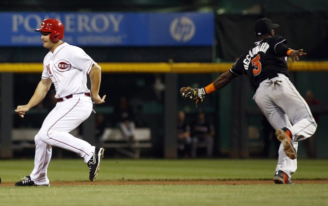 Aug 9, 2014; Cincinnati, OH, USA; Cincinnati Reds pinch hitter Chris Heisey (28) is tagged out by Miami Marlins shortstop Adeiny Hechavarria (3) in the ninth inning at Great American Ball Park. The Marlins won 4-3. Mandatory Credit: David Kohl-USA TODAY Sports