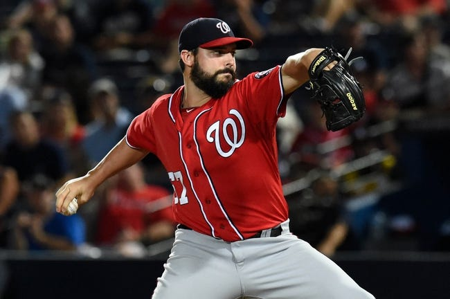 Aug 9, 2014; Atlanta, GA, USA; Washington Nationals starting pitcher Tanner Roark (57) pitches against the Atlanta Braves during the first inning at Turner Field. Mandatory Credit: Dale Zanine-USA TODAY Sports