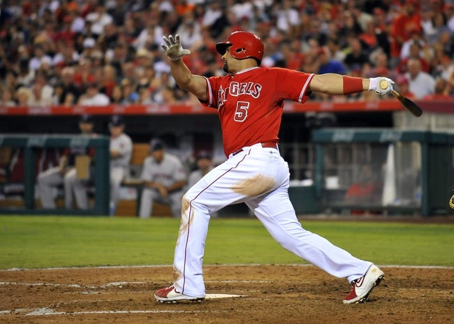 August 9, 2014; Anaheim, CA, USA; Los Angeles Angels first baseman Albert Pujols (5) at bat in the fifth inning against the Boston Red Sox at Angel Stadium of Anaheim. Mandatory Credit: Gary A. Vasquez-USA TODAY Sports