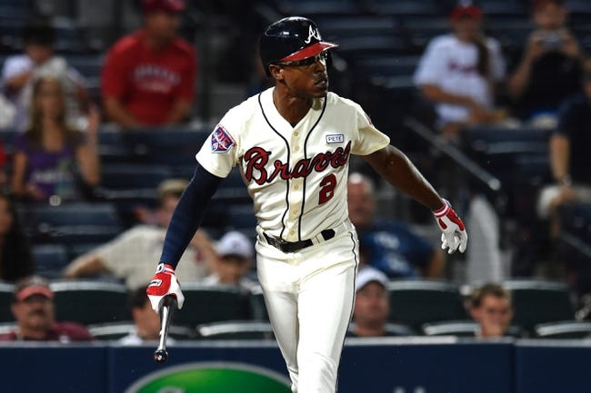 Aug 9, 2014; Atlanta, GA, USA; Atlanta Braves center fielder B.J. Upton (2) reacts after striking out against the Washington Nationals during the third inning at Turner Field. Mandatory Credit: Dale Zanine-USA TODAY Sports