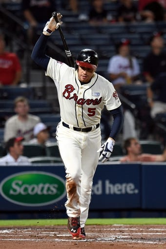 Aug 9, 2014; Atlanta, GA, USA; Atlanta Braves first baseman Freddie Freeman (5) reacts after flying out to the wall in center field against the Washington Nationals during the third inning at Turner Field. Mandatory Credit: Dale Zanine-USA TODAY Sports