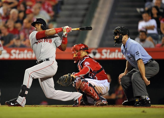 August 9, 2014; Anaheim, CA, USA; Boston Red Sox left fielder Yoenis Cespedes (52) at bat during the ninth inning against the Los Angeles Angels at Angel Stadium of Anaheim. Mandatory Credit: Gary A. Vasquez-USA TODAY Sports