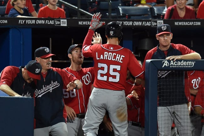 Aug 9, 2014; Atlanta, GA, USA; Washington Nationals first baseman Adam LaRoche (25) is greeted at the dugout after hitting a home run against the Atlanta Braves during the sixth inning at Turner Field. Mandatory Credit: Dale Zanine-USA TODAY Sports