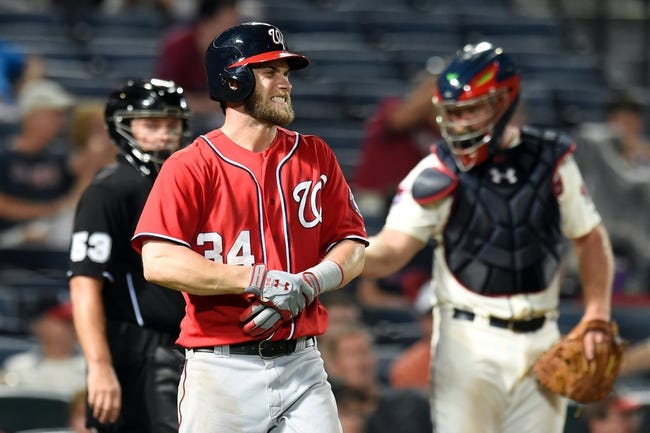 Aug 9, 2014; Atlanta, GA, USA; Washington Nationals left fielder Bryce Harper (34) reacts after being injured while batting against the Atlanta Braves during the sixth inning at Turner Field. Mandatory Credit: Dale Zanine-USA TODAY Sports