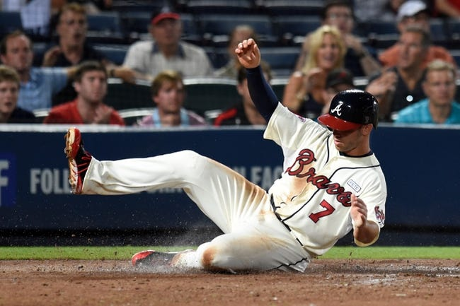 Aug 9, 2014; Atlanta, GA, USA; Atlanta Braves second baseman Tommy La Stella (7) slides home with a run against the Washington Nationals during the sixth inning at Turner Field. Mandatory Credit: Dale Zanine-USA TODAY Sports