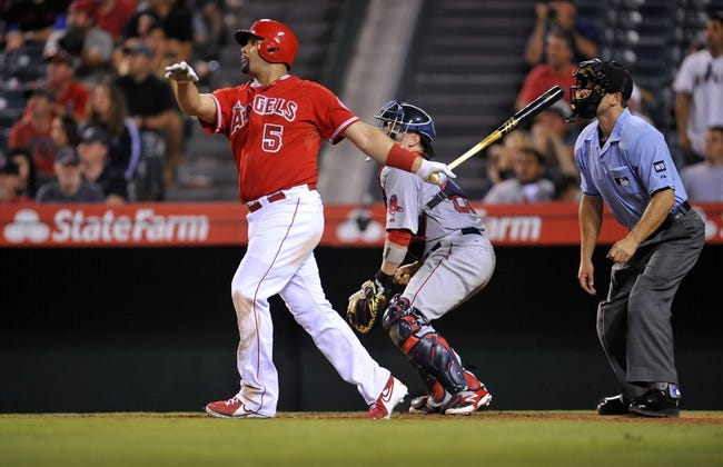 August 9, 2014; Anaheim, CA, USA; Los Angeles Angels first baseman Albert Pujols (5) hits a solo home run in the nineteenth inning against the Boston Red Sox at Angel Stadium of Anaheim. Mandatory Credit: Gary A. Vasquez-USA TODAY Sports