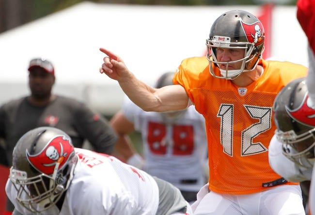 Jul 28, 2014; Tampa, FL, USA; Tampa Bay Buccaneers quarterback Josh McCown (12) points as he calls a play during training camp at One Buc Place. Mandatory Credit: Kim Klement-USA TODAY Sports