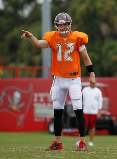 Jul 28, 2014; Tampa, FL, USA; Tampa Bay Buccaneers quarterback Josh McCown (12) during training camp at One Buc Place. Mandatory Credit: Kim Klement-USA TODAY Sports