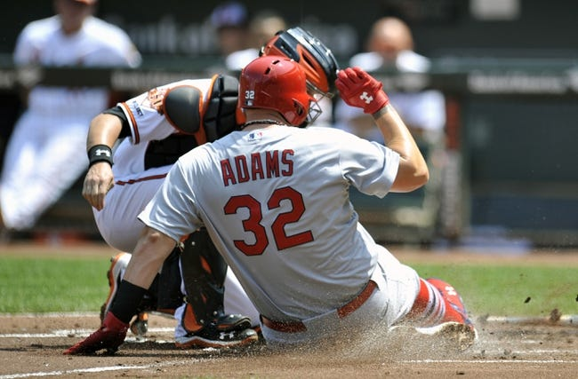 Aug 10, 2014; Baltimore, MD, USA; St. Louis Cardinals first baseman Matt Adams (32) is out at home as Baltimore Orioles catcher Caleb Joseph (36) is able to make the play in the first inning at Oriole Park at Camden Yards. Mandatory Credit: Joy R. Absalon-USA TODAY Sports