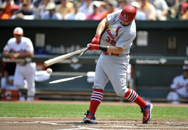 Aug 10, 2014; Baltimore, MD, USA; St. Louis Cardinals first baseman Matt Adams (32) breaks his bat on a one-run rbi  single in the first inning against the Baltimore Orioles at Oriole Park at Camden Yards. Mandatory Credit: Joy R. Absalon-USA TODAY Sports