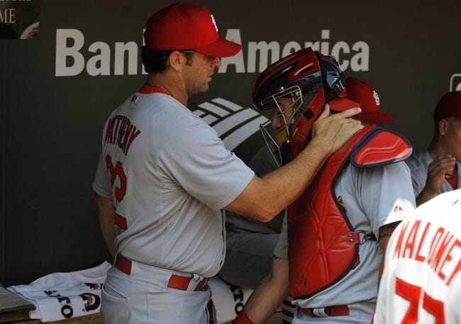 Aug 10, 2014; Baltimore, MD, USA; St. Louis Cardinals manager Mike Matheny (22) and catcher Tony Cruz (48) in the dugout prior to a game against the Baltimore Orioles at Oriole Park at Camden Yards. Mandatory Credit: Joy R. Absalon-USA TODAY Sports