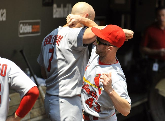 Aug 10, 2014; Baltimore, MD, USA; St. Louis Cardinals teammates Matt Holliday (7) and Shane Robinson (43) in the dugout prior to a game against the Baltimore Orioles at Oriole Park at Camden Yards. Mandatory Credit: Joy R. Absalon-USA TODAY Sports