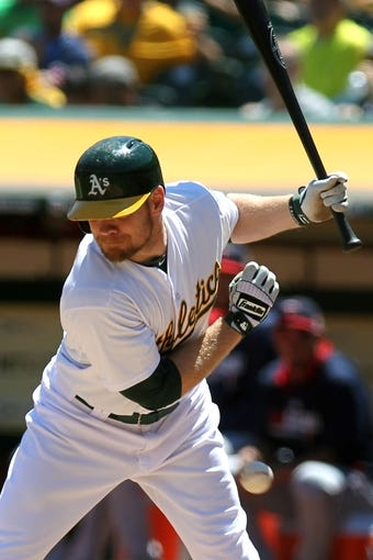 Aug 10, 2014; Oakland, CA, USA; Oakland Athletics left fielder Brandon Moss (37) is hit by a pitch in the first inning of their MLB baseball game with the Minnesota Twins at O.co Coliseum. Mandatory Credit: Lance Iversen-USA TODAY Sports