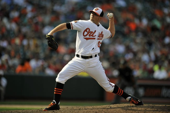 Aug 10, 2014; Baltimore, MD, USA; Baltimore Orioles pitcher Zach Britton (53) pitches in the ninth inning against the St. Louis Cardinals at Oriole Park at Camden Yards. The Cardinals defeated the Orioles 8-3. Mandatory Credit: Joy R. Absalon-USA TODAY Sports