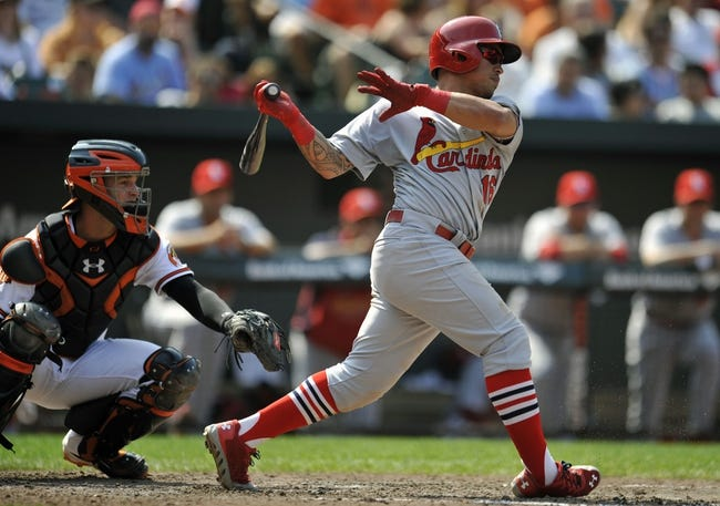 Aug 10, 2014; Baltimore, MD, USA; St. Louis Cardinals second baseman Kolten Wong (16) bats in the sixth inning against the Baltimore Orioles at Oriole Park at Camden Yards. The Cardinals defeated the Orioles 8-3. Mandatory Credit: Joy R. Absalon-USA TODAY Sports