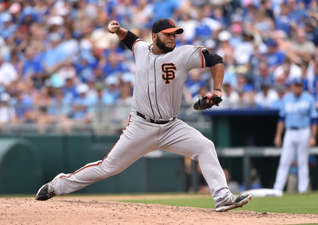 Aug 10, 2014; Kansas City, MO, USA; San Francisco Giants pitcher Yusmeriro Petit (52) delivers a pitch against the Kansas City Royals during the sixth inning at Kauffman Stadium. Kansas City defeated San Francisco 7-4. Mandatory Credit: Peter G. Aiken-USA TODAY Sports