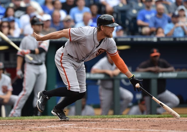 Aug 10, 2014; Kansas City, MO, USA; San Francisco Giants right fielder Hunter Pence (8) hits an RBI single against the Kansas City Royals during the seventh inning at Kauffman Stadium. Kansas City defeated San Francisco 7-4. Mandatory Credit: Peter G. Aiken-USA TODAY Sports