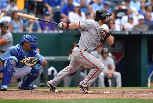 Aug 10, 2014; Kansas City, MO, USA; San Francisco Giants center fielder Angel Pagan (16) singles against the Kansas City Royals during the seventh inning at Kauffman Stadium. Kansas City defeated San Francisco 7-4. Mandatory Credit: Peter G. Aiken-USA TODAY Sports