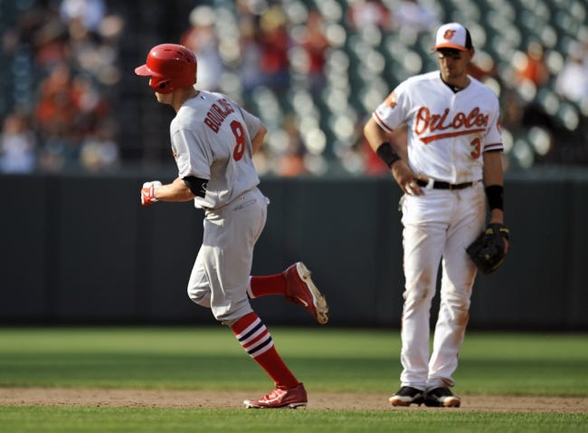 Aug 10, 2014; Baltimore, MD, USA; St. Louis Cardinals center fielder Peter Bourjos (8) rounds the bases after hitting a three-run home run in the ninth inning against the Baltimore Orioles at Oriole Park at Camden Yards. The Cardinals defeated the Orioles 8-3. Mandatory Credit: Joy R. Absalon-USA TODAY Sports