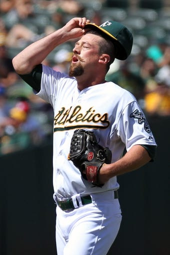 Aug 10, 2014; Oakland, CA, USA; Oakland Athletics starting pitcher Luke Gregerson (44) reacts in the eighth inning against the Minnesota Twins at O.co Coliseum. Twins won 6-1. Mandatory Credit: Lance Iversen-USA TODAY Sports.