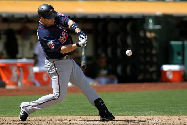 Aug 10, 2014; Oakland, CA, USA; Minnesota Twins designated hitter Josh Willingham (16) hits a two run home run in the eighth inning against the Oakland Athletics at O.co Coliseum. Twins won 6-1. Mandatory Credit: Lance Iversen-USA TODAY Sports..