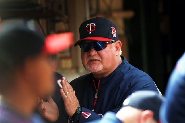 Aug 10, 2014; Oakland, CA, USA; Minnesota Twins manager Ron Gardenhire (35) applauds his team in the eighth inning of their MLB baseball game with the Oakland Athletics at O.co Coliseum. Mandatory Credit: Lance Iversen-USA TODAY Sports. Twins won 6-1.