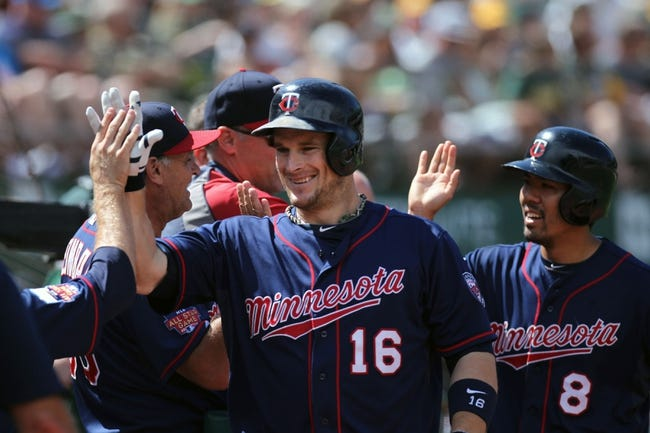 Aug 10, 2014; Oakland, CA, USA; Minnesota Twins designated hitter Josh Willingham (left) and catcher Kurt Suzuki (8) are greeted at the dugout after Willingham hit a two run home run in the eighth inning against the Oakland Athletics at O.co Coliseum. Mandatory Credit: Lance Iversen-USA TODAY Sports. Twins won 6-1.