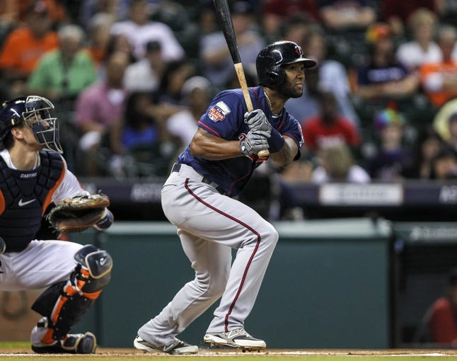 Aug 11, 2014; Houston, TX, USA; Minnesota Twins center fielder Danny Santana (39) gets a single during the first inning against the Houston Astros at Minute Maid Park. Mandatory Credit: Troy Taormina-USA TODAY Sports