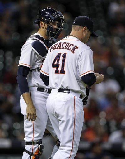 Aug 11, 2014; Houston, TX, USA; Houston Astros catcher Jason Castro (15) talks with starting pitcher Brad Peacock (41) during the first inning against the Minnesota Twins at Minute Maid Park. Mandatory Credit: Troy Taormina-USA TODAY Sports