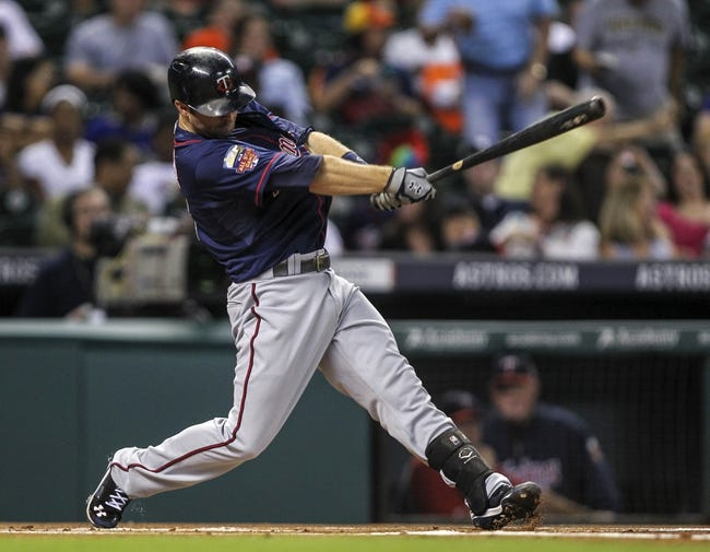 Aug 11, 2014; Houston, TX, USA; Minnesota Twins second baseman Brian Dozier (2) hits a double during the first inning against the Houston Astros at Minute Maid Park. Mandatory Credit: Troy Taormina-USA TODAY Sports